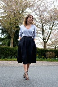 cashmere sweater with a white collared shirt, black pencil skirt, and high heels